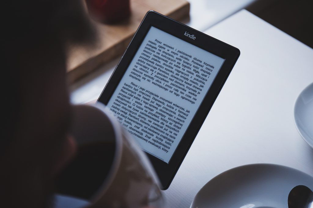 person reading on their kindle