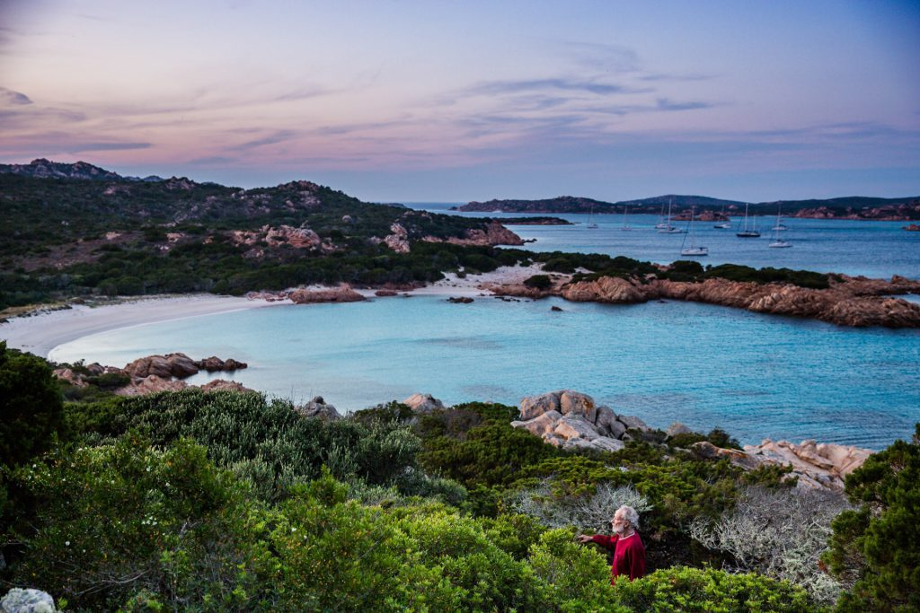 Sardinia's Budelli Island in Italy - hilltop scenic view, ocean in the background and yachts in the distance